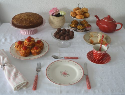 An afternoon tea buffet with a carrot cake muffins and tea