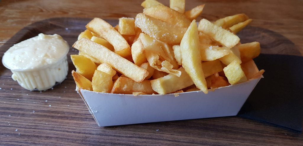 "A small portion of fries served with mayo at the Restaurant ""La Frite"" in Liege, Belgium"