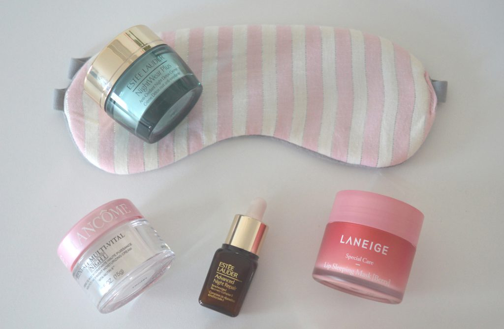 Cosmetic Products for night time skin care routine and a sleeping mask on a white table