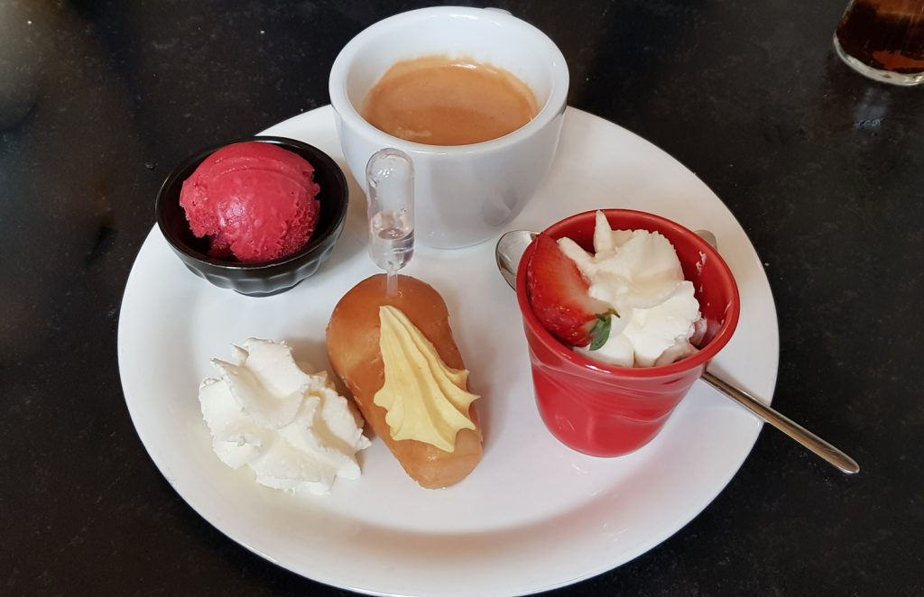 "Coffee served with three small sweets as Cafe Gourmand at ""Il Giardini"" Restaurant in Liege, Belgium"
