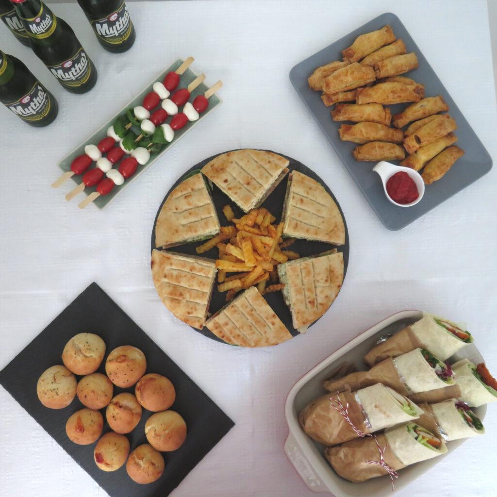 Football evening buffet at home with greek burger club sandwich